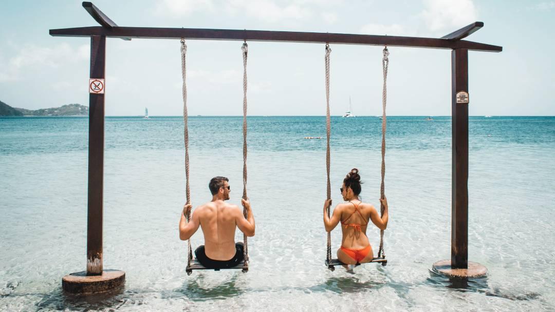 couple on a beach swing St Lucia