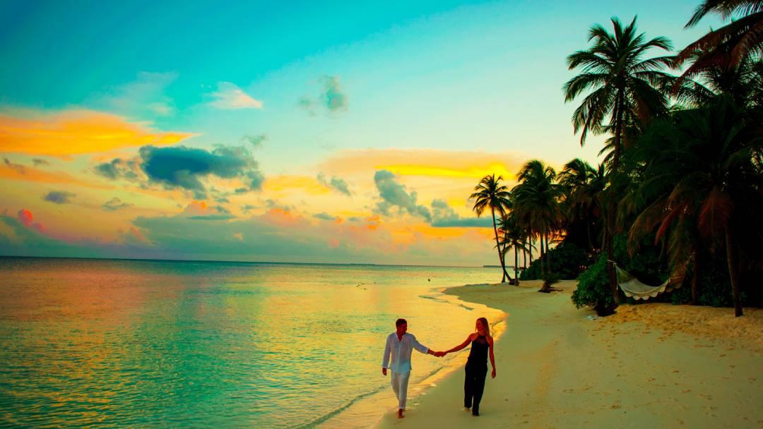 man and woman walking on Maldives