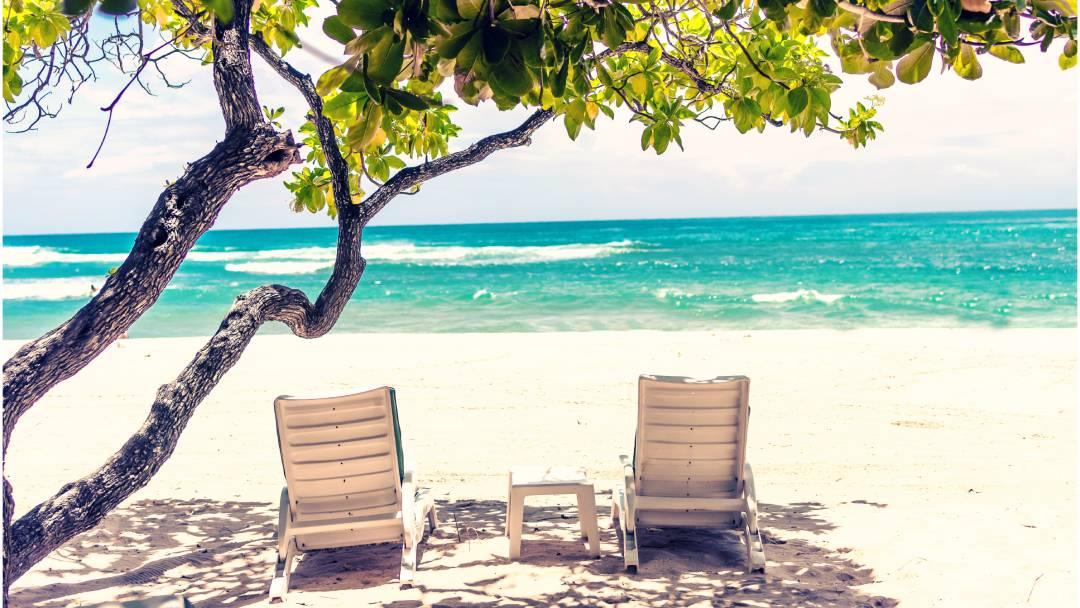 outdoor loungers on seashore Treasure Cay