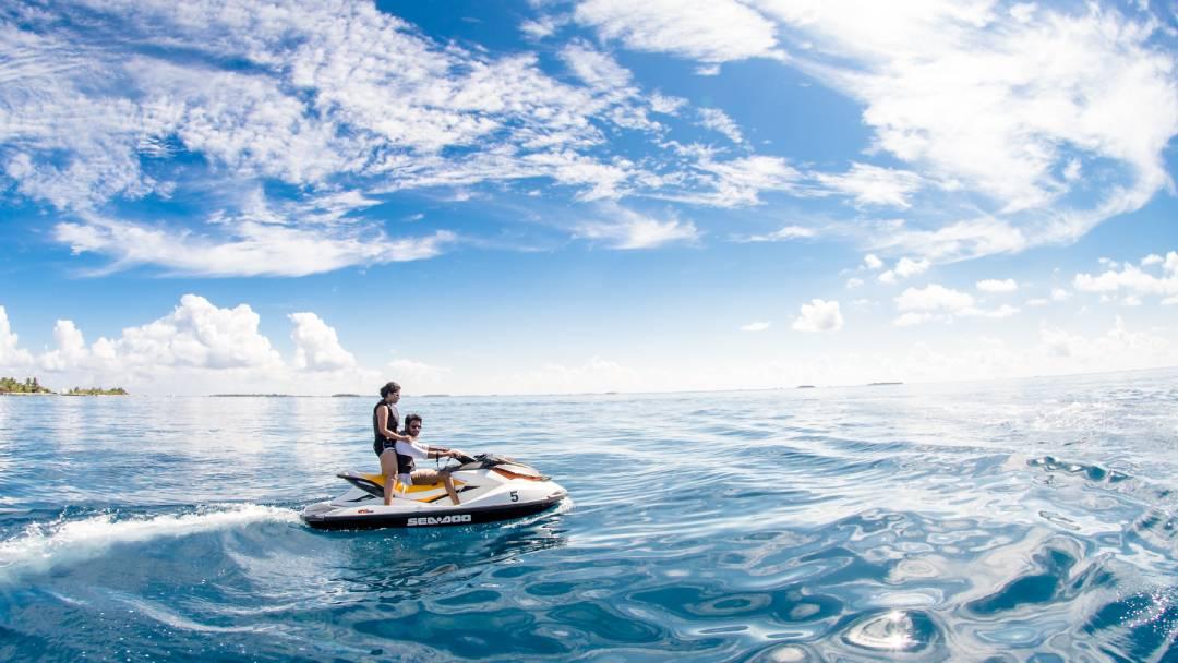 two people riding-on jet ski on Maldives