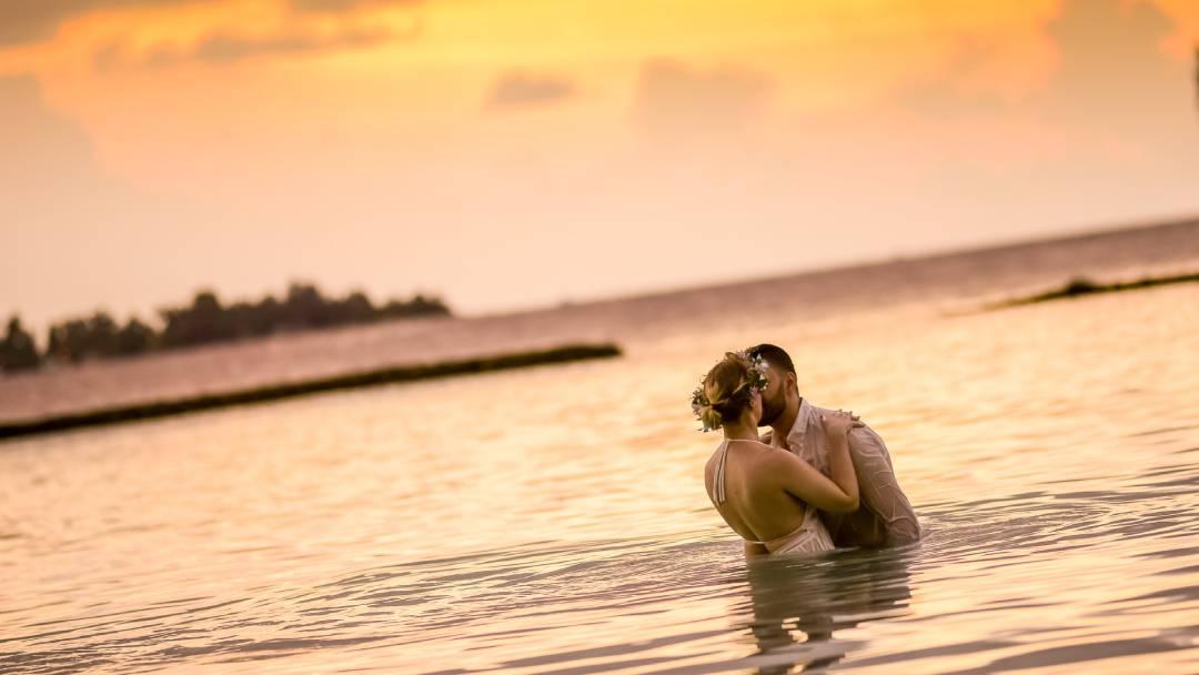 woman and man kissing on honeymoon